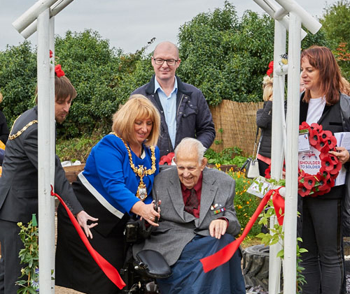 Cllr Karen Mundry and veteran Ken Preter officially opening the Remembrance Garden.
