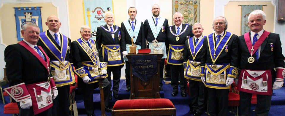 Phil Ashton (centre) surrounded by various grand and Provincial grand officers.