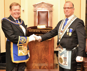 Kevin Poynton (left) congratulating John McKenzie.