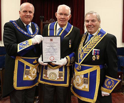 David Winder (left) and Steve Bolton present Alan Jackson (centre) with his celebration certificate.