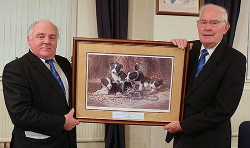 Terry McGill (left) receives the painting from Alan as a gift to the hall.