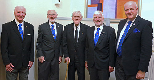 David Winder (right) looks on as Alan (second left) joins Gordon, Stan, and John in the '50 years membership club'.