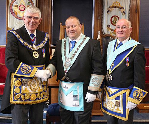 Tony Harrison (left) congratulating Phillip Woods(centre) and Bill Woods.