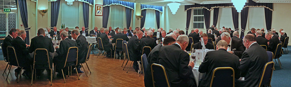Diners enjoy a hearty meal at the celebration.