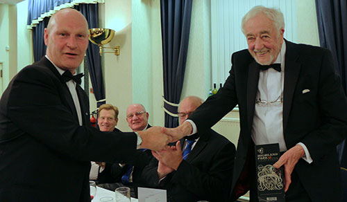 Michael Monks (left) presents Tom with a libation from Longridge Lodge.