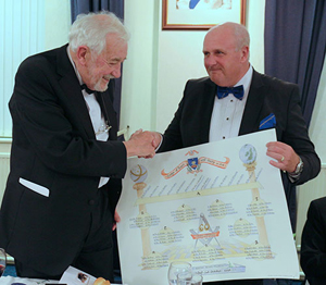 David Winder (right) presents Tom with the evening's table plan