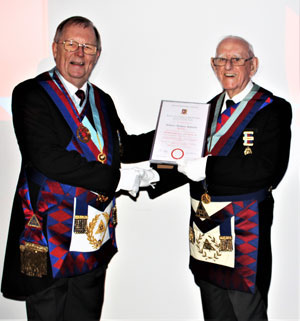 Colin Rowling (left) presents Tony with his 60th anniversary certificate.