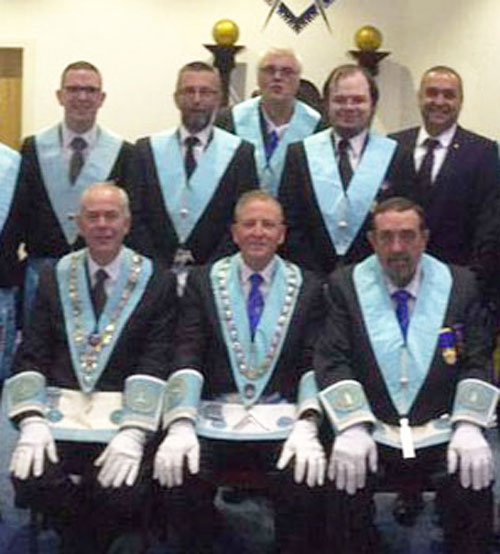 Pictured seated from left to right, are: Alan Brocking (junior warden), Mike Hindle (WM) and Paul Domville (senior warden), with lodge members.