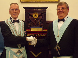 Les Gilston (right) hands over the reins to Dave Weatherby.