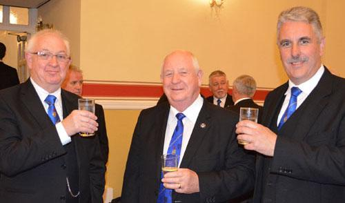 Harry Cox (centre) congratulating Kevin Hickman (left) with Andy Barton (right).