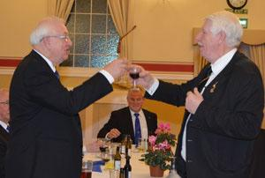 Kevin (left) being toasted by Norman Pritchard during the master's song.