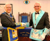 The brethren of Holmes Lodge No 2708, were honoured and delighted to receive the Assistant Provincial Grand Master David Ogden as the principal guest at their installation ceremony at Hindley Masonic Hall. David was supported by the Chairman of Wigan Group Geoffrey Porter, group secretary Chris Reeman and the group charity steward Ian Green. Also present were acting Provincial grand officers, Christopher Maloney and Eric Bailey, who was also on duty as the lodge secretary. They had gathered on this special night for the lodge to witness the installation of John Hector Davies. At the request of WM Keith Woodall, John was installed by Tim Fleming, the lodge ADC, in a very competent manner. Tim, who has previously served as WM twice in this lodge, has been called upon to carry out installation ceremonies on many other occasions in recent times. It was a team effort. The working tools were presented by the lodge DC John Bimpson, Peter Johnson and Ian Lythgoe, who had only been initiated in April 2018. Alan Brown addressed the WM, Malcolm Currie the wardens and David Ogden the brethren of the lodge. At the completion of the installation ceremony, David had the privilege of bringing the greetings of the Provincial Grand Master Tony Harrison and congratulated John on attaining the chair in this prestigious lodge. He thanked the installing master, the director of ceremonies and lodge secretary for their careful work and preparations ahead of the meeting. New WM John presented David with cheques for the MCF 2021 Festival, West Lancashire Freemasons' Charity and Hindley Masonic hall. The donation to the MCF Festival qualified the lodge as Vice Patron and it was a pleasant duty for David to present the certificate to the lodge in the presence of the assembled brethren. At the festive board over £200 was raised to start off the year's charity coffers in a quick and efficient manner. In his response to the toast to his health, David informed the assembled brethren that Holmes Lo