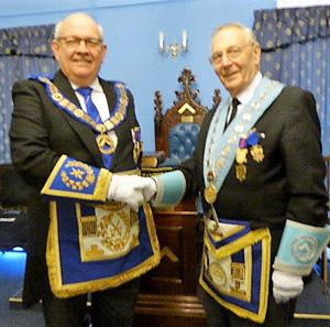 lan Carter (right) welcomes Philip Gunning