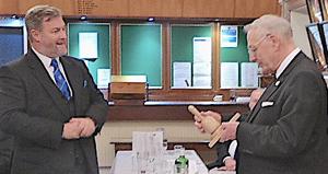 David Boyes (left) presents Alan Carter with commemorative gavel