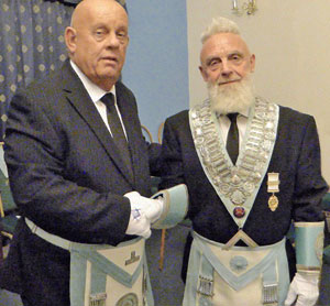 Stephen Lawler (left) congratulating Stephen Robinson.