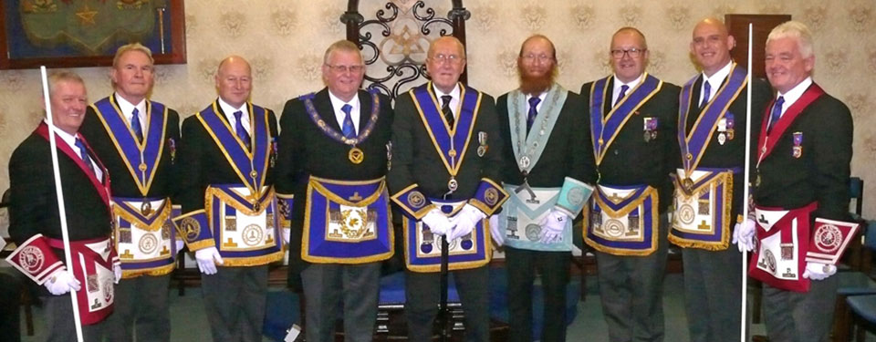 Jim Bolton with the Stewart Seddon, grand and acting Provincial grand officers and the WM.