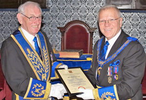 Derek Parkinson (right) presents Peter Williams with his jubilee certificate.