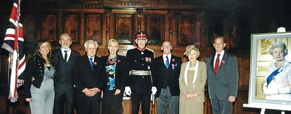 Pictured from left to right, are: Tracy Williams, Tony Ackroyd, Wally James, Linda Griffiths, David Briggs (Lieutenant of Cheshire), Jim Corcoran, Pat James and Howard Griffiths.