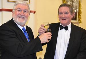 John Robson (left) and Jim Hamilton toasting each other's health.