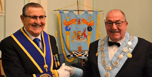 George Shields of Victoria Lodge No 4629 (left), congratulates his longstanding friend Adrian on attaining the chair once again