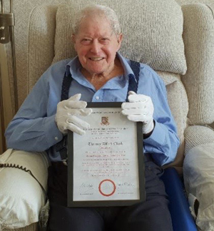 Tom Clark and his 50-year certificate.