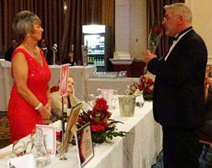 Lynda Whalley receives a rose from John Gillan.