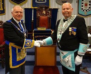 Derek Parkinson (left) congratulates Ian Winnard