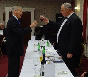 Roger Lloyd-Jones (left) toasts Mark Spragg during the master's song.