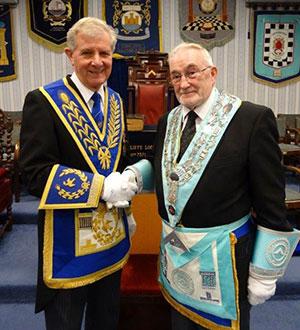Stuart Thornber (left) congratulates Neil Kirkpatrick.