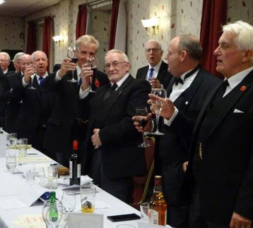 The brethren toast the new master Neil, during the master's song