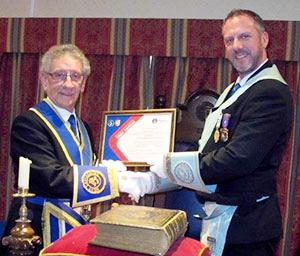 Malcolm Sandywell (left) presenting the lodge's Vice Patron Certificate for the MCF 2021 Festival to Rob Midgley.