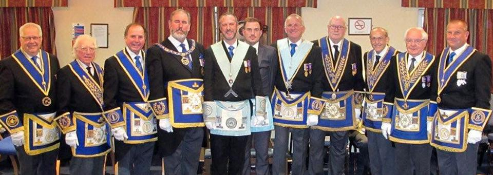 Pictured from third left, are: Graham Chambers, Frank Umbers, Rob Midgley, Chris Hayton, and Derek Midgley, together with grand and acting Provincial grand officers.