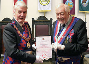 Paul Renton (left) presents Tom with his certificate of achievement