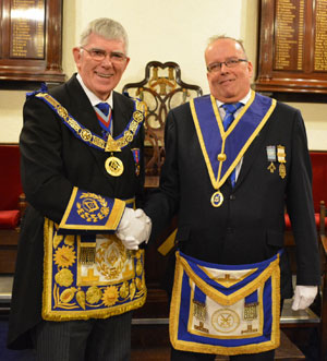 Tony Harrison (left) congratulating Quentin Newhall on his appointment to Provincial grand rank.