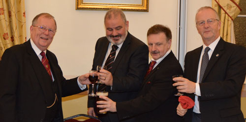 Colin Rowling (left) taking wine with the three principals.
