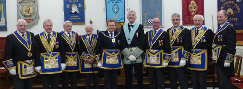 Neil (centre) flanked by Kevin Poynton on his right and Neil Pedder on his left with grand and acting Provincial grand officers.