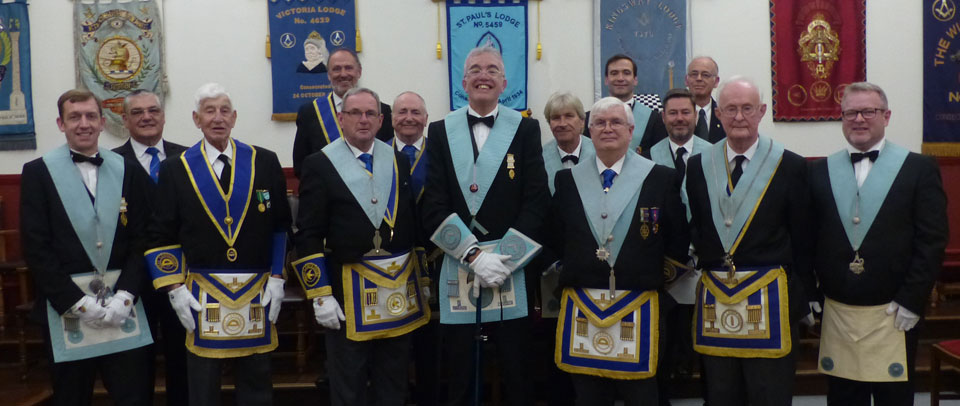 Neil (centre) surrounded by some members of his lodge.