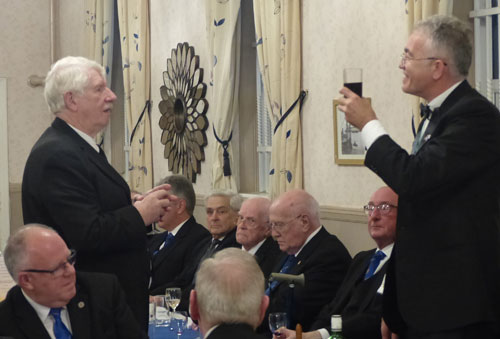 Norman Pritchard (left) gives the toast to Neil during the master's song.