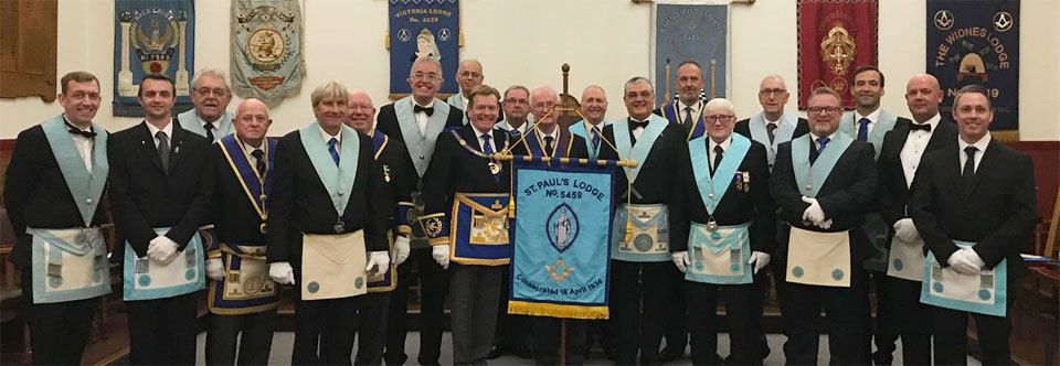 Members of St Paul's Lodge proudly display their banner.