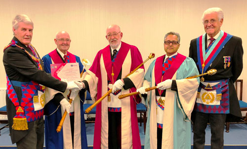 Presenting a festival certificate, pictured from left to right, are: Paul Renton, Eddie Atherton, John Seddon, Roy Kholi and Malcolm Warren.