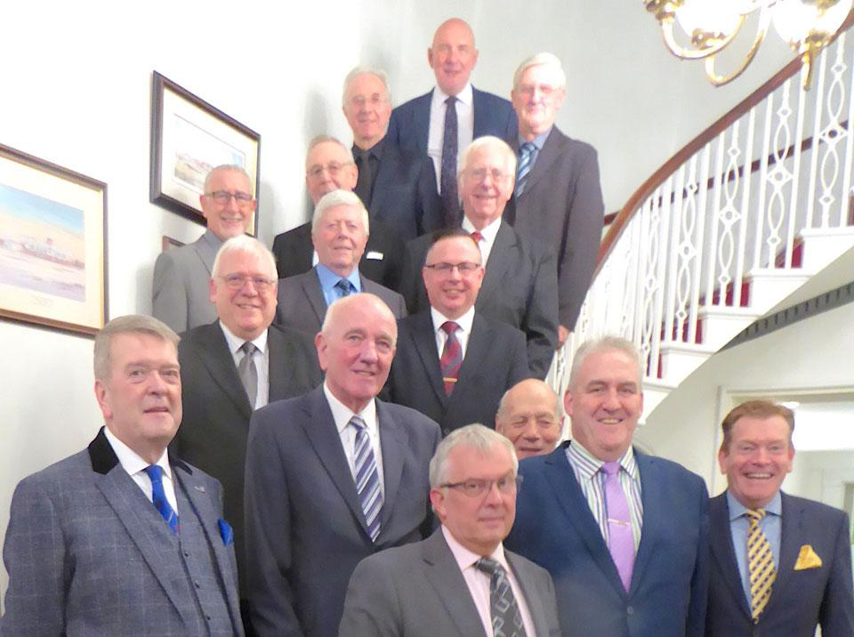 Recipients on the staircase, together with Andy Whittle (front row second right) and Kevin Poynton (front row right).