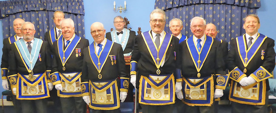 Peter Ryan (rear row, centre) is congratulated by the brethren of the lodge.