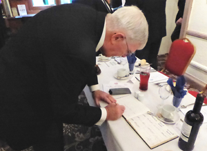 Tony Harrison signs the logbook.