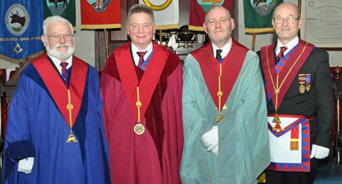Pictured from left to right, are the three principals: Ken Morris, Duncan Hopkins, Derek English and installing first principal John Dowsett.