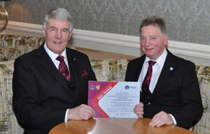 Paul Renton (left) and Duncan Hopkins discussing the MCF vice patron's certificate.
