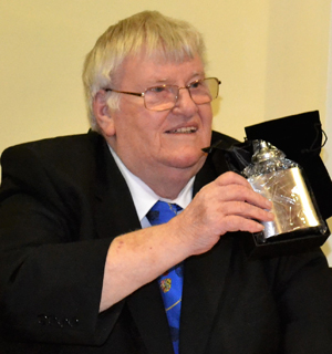 Colin Martin proudly shows off his gift from Vale Lodge.