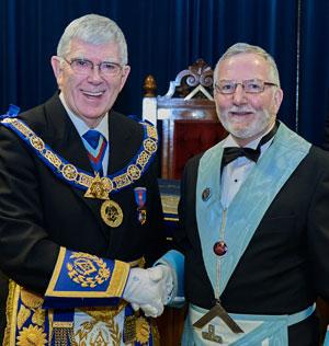 Tony (left) congratulates John on attaining the chair of Lilford Lodge.