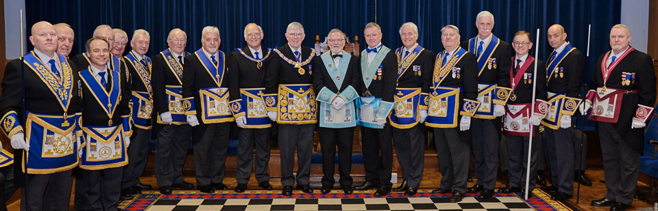 Tony and John (centre) surrounded by acting Provincial grand officers and grand officers.