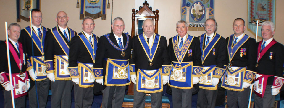 Colin (centre) surrounded by various grand and Provincial grand officers.