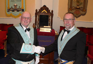 John (left) being congratulated by his installing master, Carl Daggers.